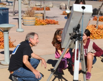 President Dennis Jamison with a Junior Astronmer and Telescope